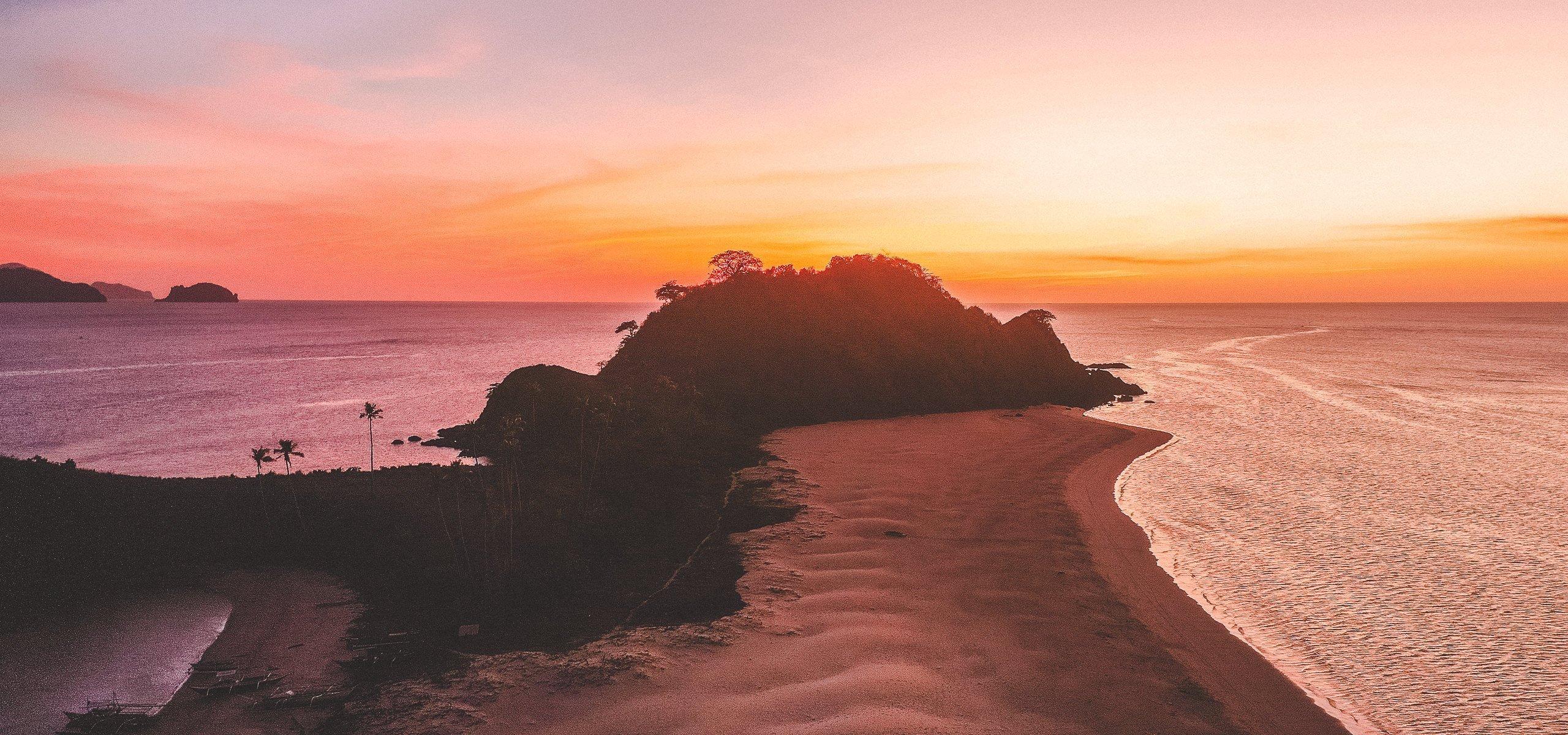 Drone capturing sunset at Nacpan Beach, El Nido