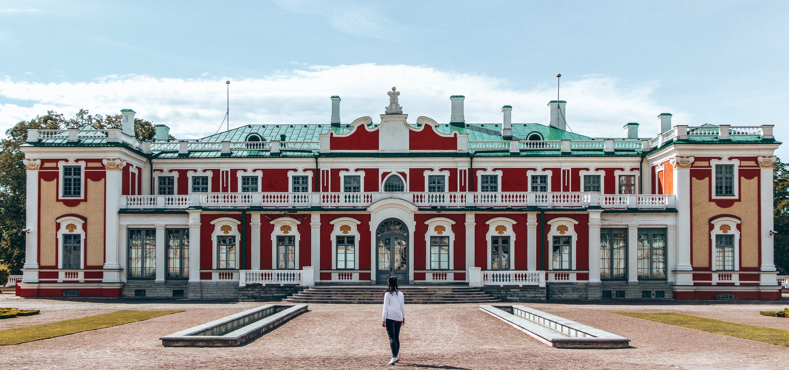 A girl stands before Kadriorg Palace in Tallinn, Estonia