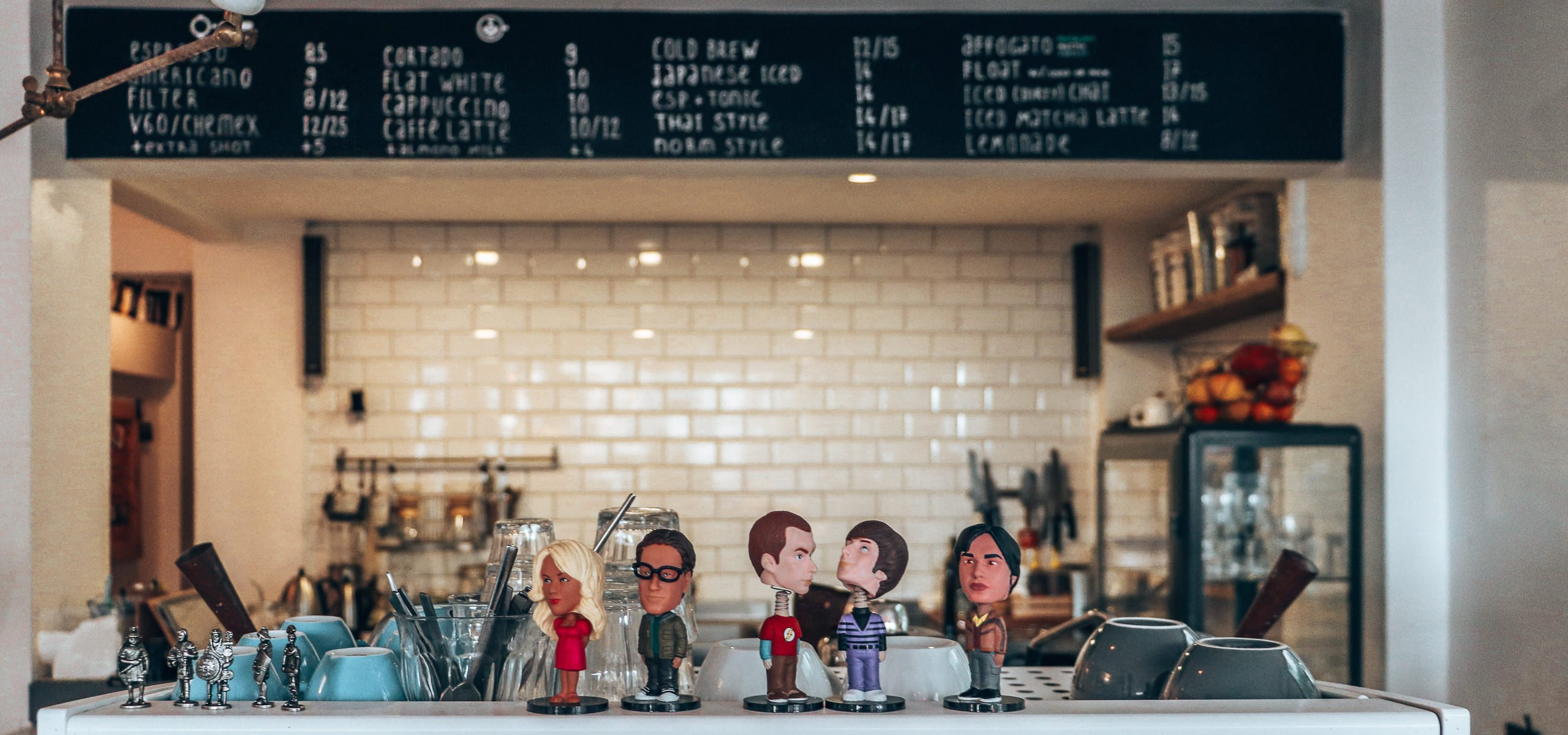 Bobblehead figurines atop the coffee machine at Norm Coffee, Istanbul, Turkey