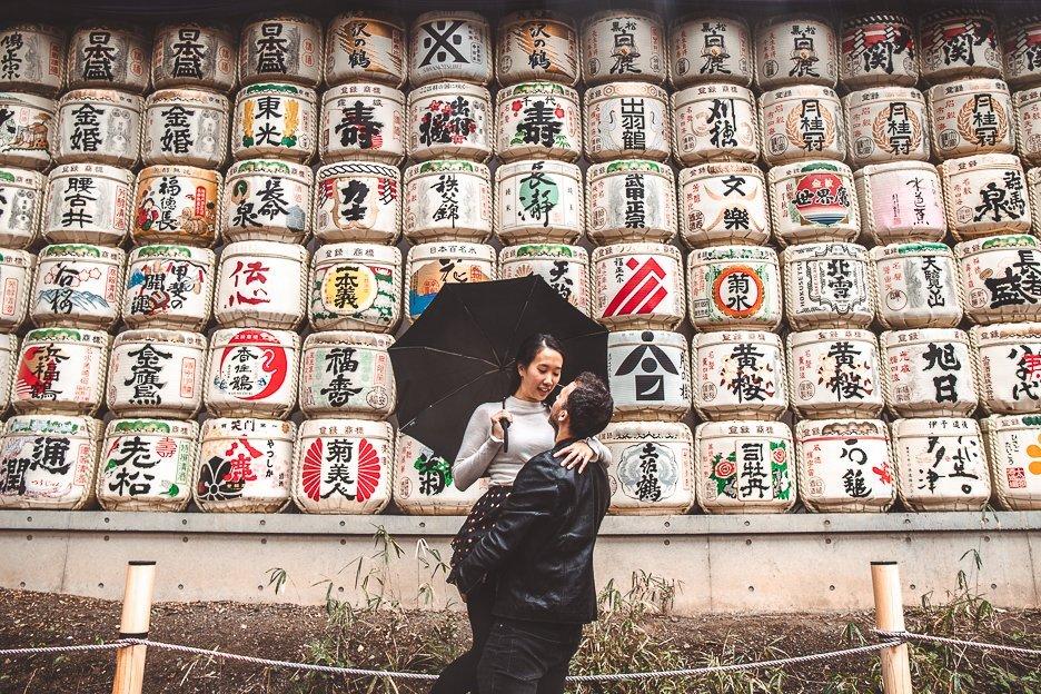 A couple in front of the sake barrels at Meiji Shrine, Tokyo