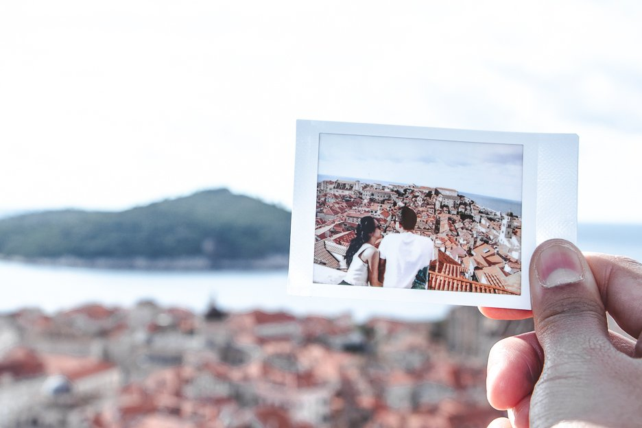 A polaroid shot of a couple overlooking Dubrovnik Old Town