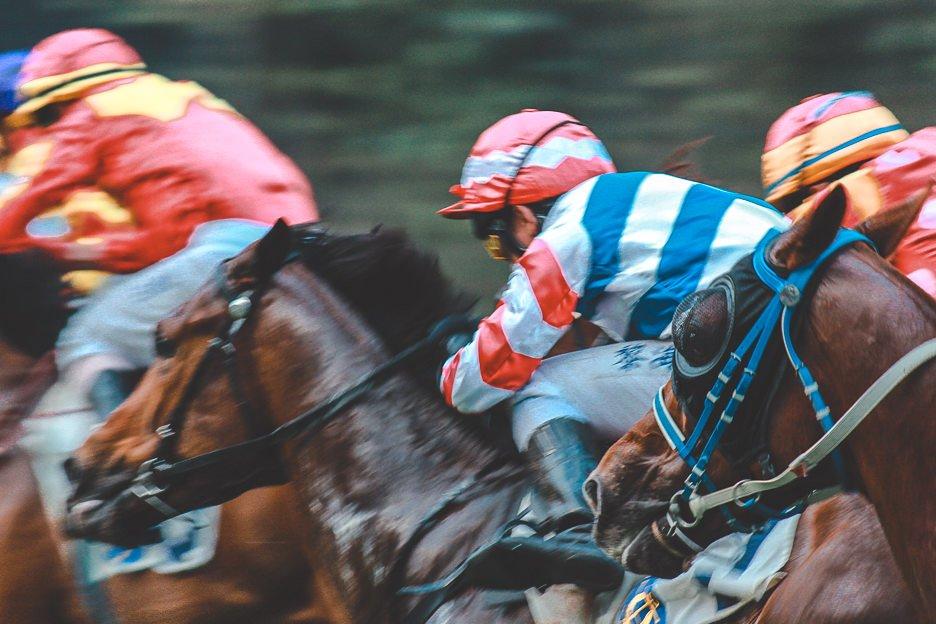 Horse racing jockeys at Happy Valley racecourse, Hong Kong