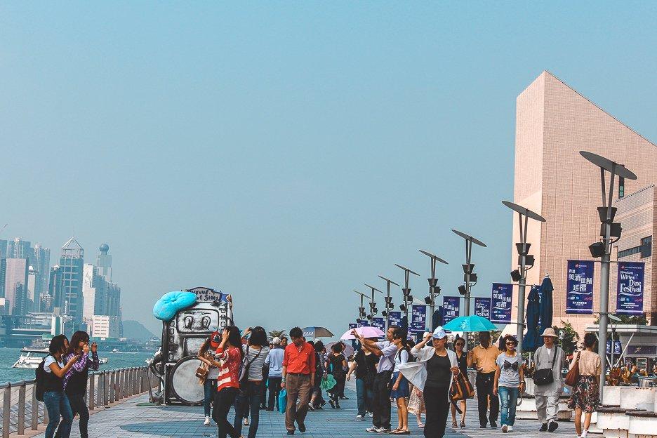 Pedestrians walking along Avenue of Stars in Hong Kong