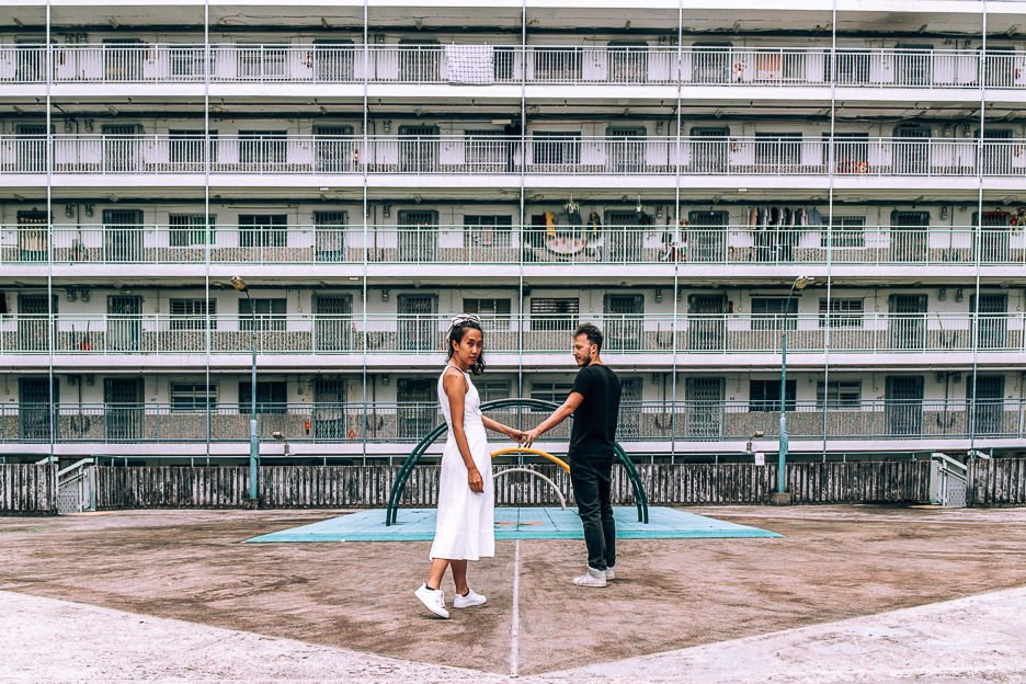 4 day Hong Kong Itinerary - a couple pose in the playground of Nam Shan Estate