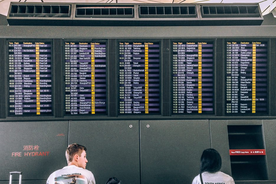 Travel Planning Resources | Looking at the departures board at an airport