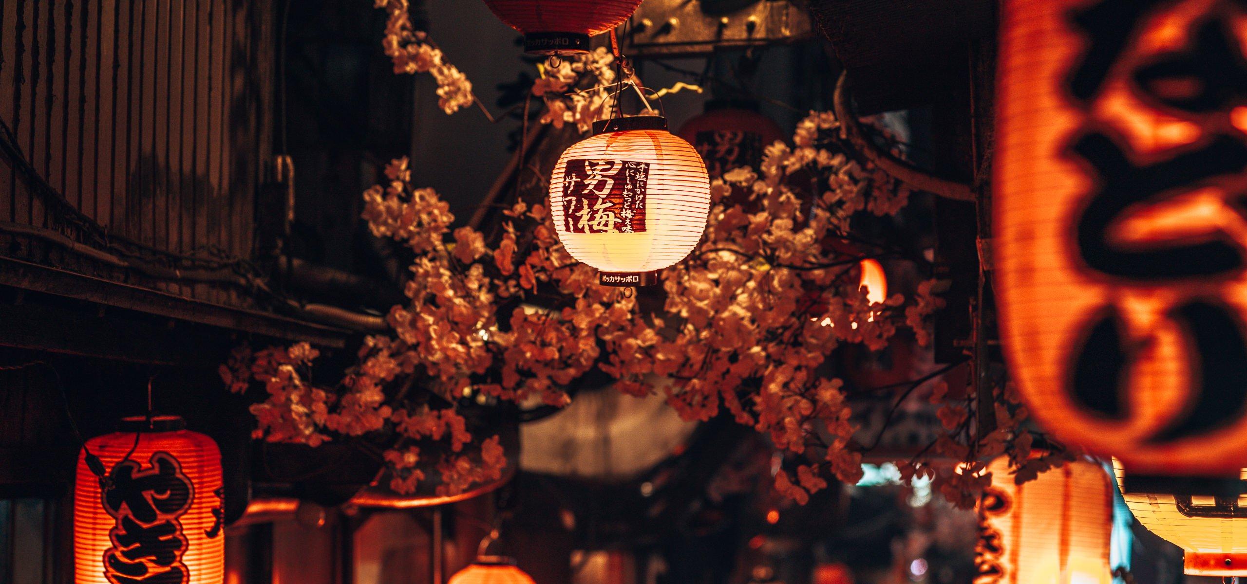 Glow of lanterns at night in Shinjuku Tokyo